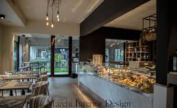 marchi-interior-design-arredamenti-retail-salumeria-gastronomia-bar-dettaglio-posti-a-sedere-bancone-esposizione